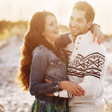 Lovely young couple on the sunset beach Stock Images
