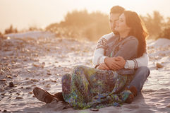 Lovely young couple on the sunset beach Royalty Free Stock Image