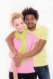 Lovely young couple on the white background. Young people standing together- white woman,black man Royalty Free Stock Images
