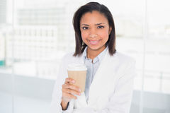 Lovely young dark haired businesswoman holding a cup of coffee Stock Images