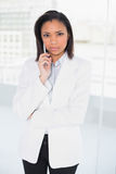 Lovely young dark haired businesswoman posing looking at camera Royalty Free Stock Image