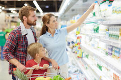 Lovely young family in supermarket Royalty Free Stock Photo