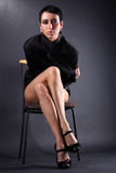 Lovely young fashion model in big man coat Stock Images