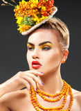 Lovely young fashion model with bouquet of rowan on head Stock Photography