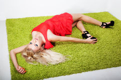 Lovely young female blonde laying in grass stock photos