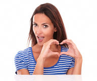Lovely young female with heart sign Stock Photography