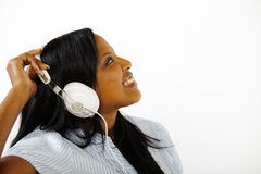 Lovely young female listening to music Royalty Free Stock Photography