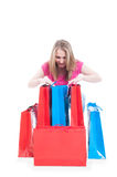 Lovely young female with a lot of shopping bags Stock Image