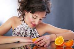 Lovely young female with oranges. Stock Photo