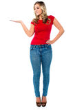 Lovely young female presenting copy space Royalty Free Stock Photo