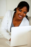 Lovely young female smiling and looking to laptop Royalty Free Stock Photo