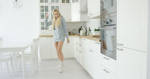 Lovely young girl dancing in kitchen Stock Photo