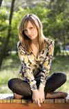 Lovely young girl relaxing in a park Royalty Free Stock Photo