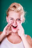 Lovely young girl screaming, hands close to mouth Stock Photo