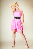 Lovely young girl wearing short pink dress royalty free stock image
