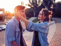 Lovely young hipster couple dating during summer sunset. They wear jeans clothes. modern youth relationship. She is stock image