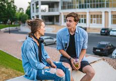 Lovely young hipster couple dating during summer sunset. They wear jeans clothes. modern youth relationship stock photo