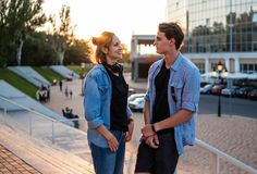 Lovely young hipster couple dating during summer sunset. They wear jeans clothes. modern youth relationship royalty free stock photography