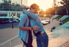Lovely young hipster couple dating during summer sunset. They wear jeans clothes. modern youth relationship royalty free stock photos