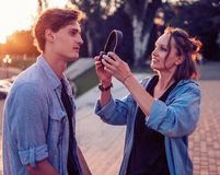 Lovely young hipster couple dating during summer sunset. They wear jeans clothes. modern youth relationship. She is stock photos