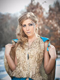 Lovely young lady in elegant dress posing winter scenery, royal look Royalty Free Stock Images