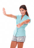 Lovely young lady gesturing a greeting Royalty Free Stock Photography