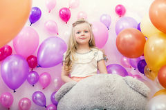 Lovely young lady posing with colorful balloons Royalty Free Stock Photos