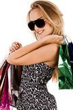 Lovely young model with shopping bags Royalty Free Stock Images