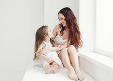 Lovely young mother and daughter having fun at home Royalty Free Stock Image