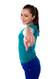 Lovely young pointing towards you Royalty Free Stock Photography