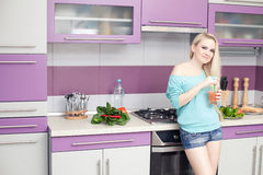 Lovely young pregnant woman enjoying fresh fruit juice in her mo Royalty Free Stock Images