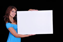 Lovely young teen holding a sign Royalty Free Stock Photo