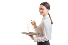 Lovely young waitress in uniform with trey Royalty Free Stock Image
