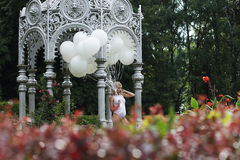 Lovely Young Woman with Balloons in the Park Royalty Free Stock Images