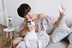 Lovely Young Woman With Nude Makeup Touching With Love Her Beagle