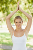 Lovely young woman doing yoga in a park Royalty Free Stock Photography