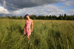 Lovely young woman on farm Royalty Free Stock Image