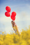 Lovely young woman in field Royalty Free Stock Photography