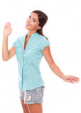 Lovely young woman gesturing a greeting Stock Photo