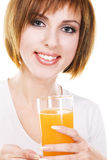 Lovely young woman with a glass of fresh juice Stock Image