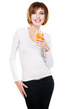 Lovely young woman with a glass of fresh juice Royalty Free Stock Image