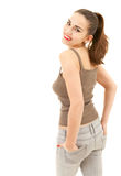 Lovely young woman with hands in pockets Stock Photo