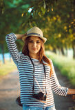 Lovely young woman in a hat riding a bicycle in a park Royalty Free Stock Photo