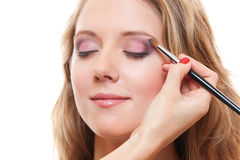 Lovely young woman having make up Royalty Free Stock Photography