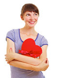 Lovely young woman with heart-shaped box Stock Photos