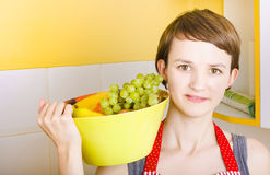 Lovely young woman holding bowl of fruit salad Stock Image