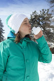 Lovely young woman kissing snow heart Royalty Free Stock Images