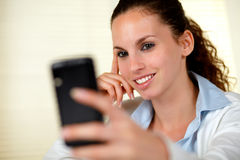 Lovely young woman kissing to cellphone Royalty Free Stock Image