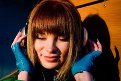 Free Lovely Young Woman Listening Music In Headphones Stock Photo - 7142990