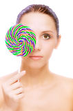 Lovely young woman with lolipop Stock Photos